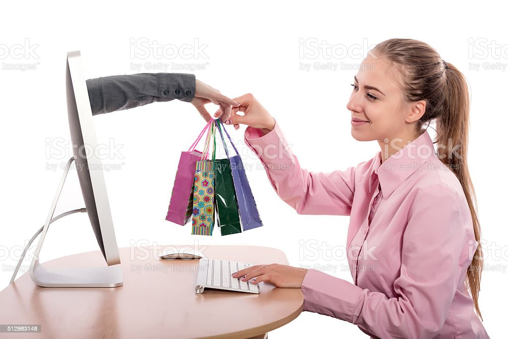 Internet Shopping and Delivery young Woman gets Purchases stock photo