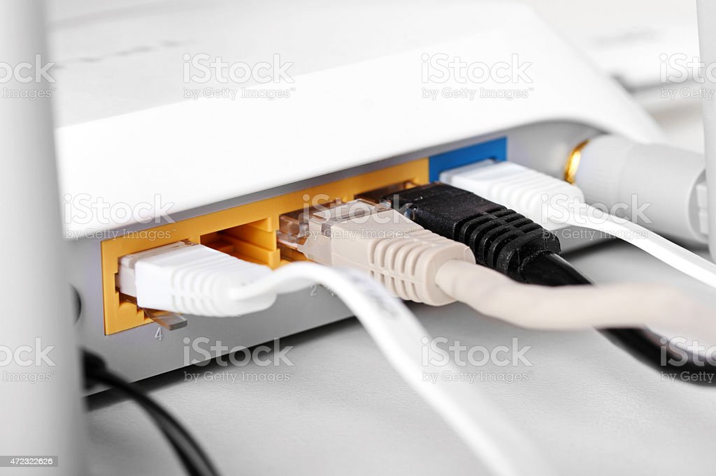 internet wireless router with plugged cables stock photo