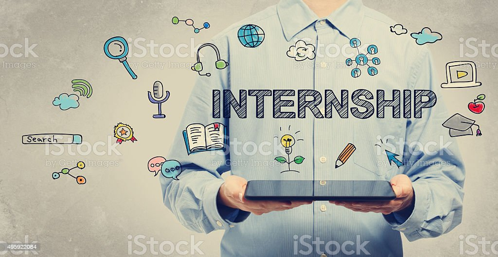 Internship concept with young man holding a tablet stock photo