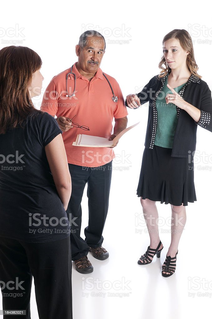 ASL Interpreter Helps Doctor and Patient Communicate royalty-free stock photo