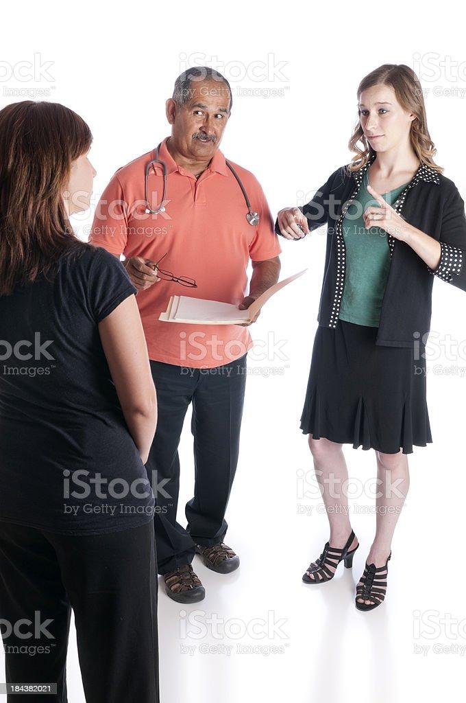 ASL Interpreter Helps Doctor and Patient Communicate stock photo