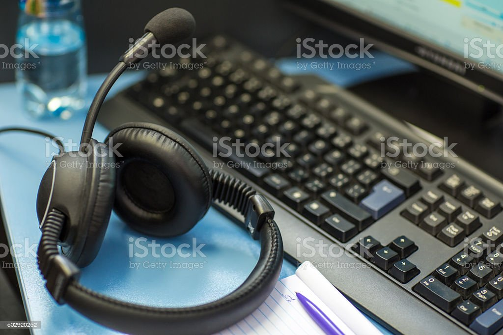 Interpreting - Headset with microphone and a computer stock photo
