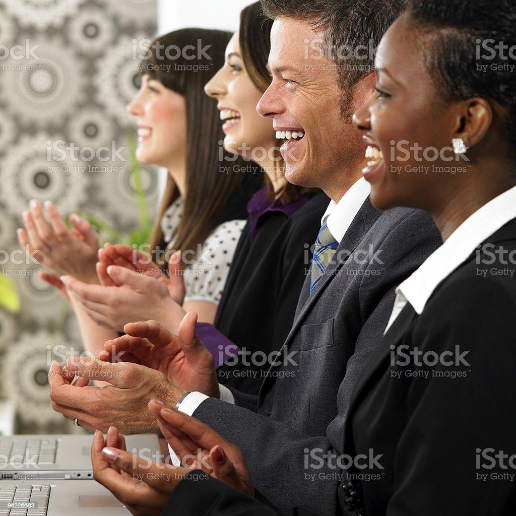 Interracial Business group appreciating a presentation stock photo