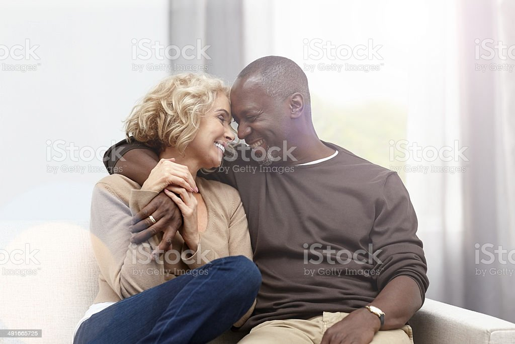 Interracial couple caught in a romantic moment stock photo