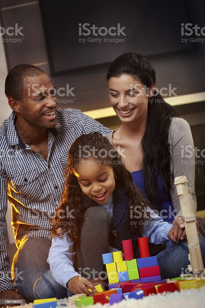 Interracial family at home playing smiling stock photo