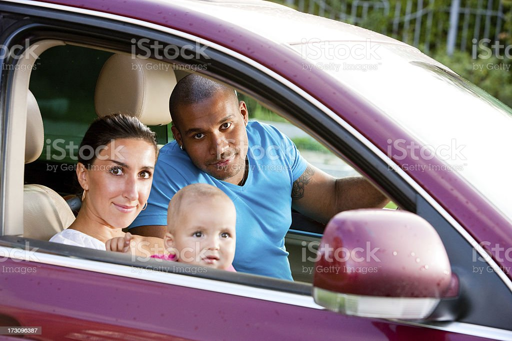 Interracial family with One year old child in a car royalty-free stock photo