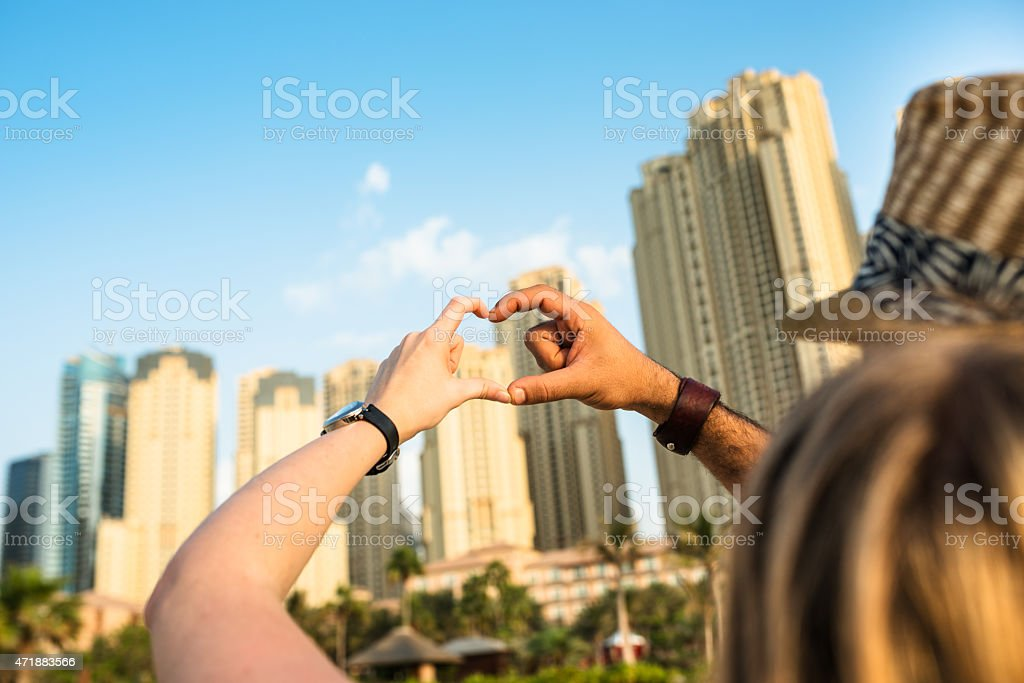 interracial heart shape gesturing stock photo