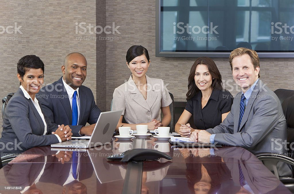 Interracial Men & Women Business Team Meeting in Boardroom royalty-free stock photo