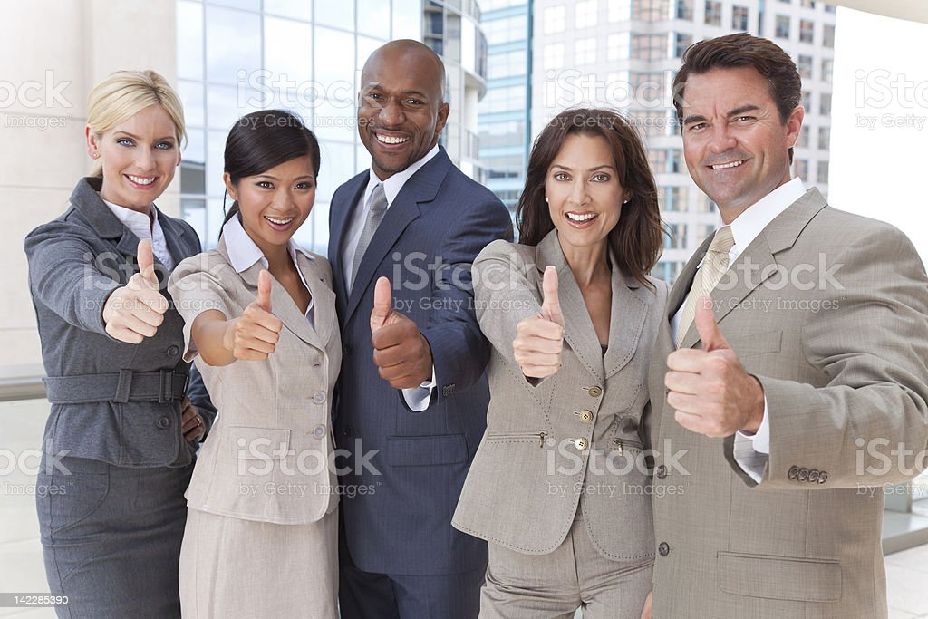 Interracial Men & Women Business Team Thumbs Up stock photo