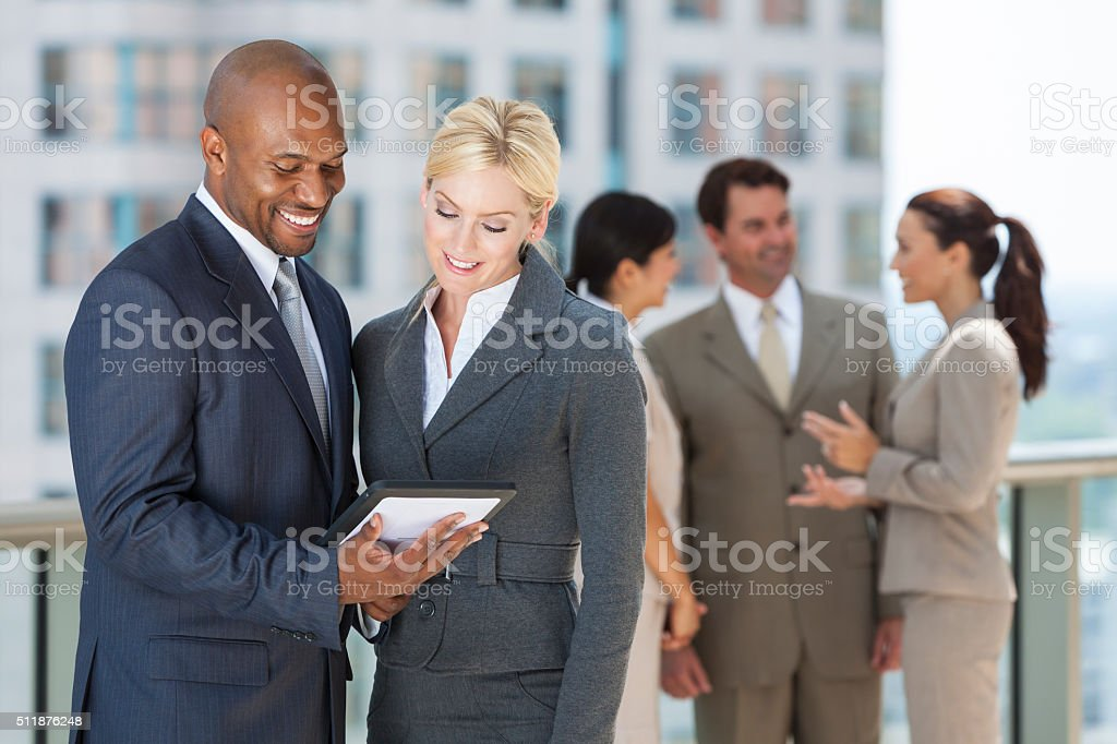 Interracial Men & Women Business Team With Tablet Computer stock photo