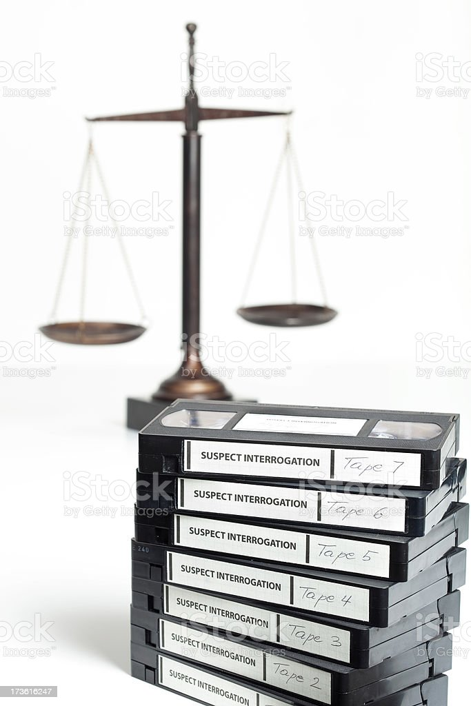 Interrogation tapes and scale of justice royalty-free stock photo