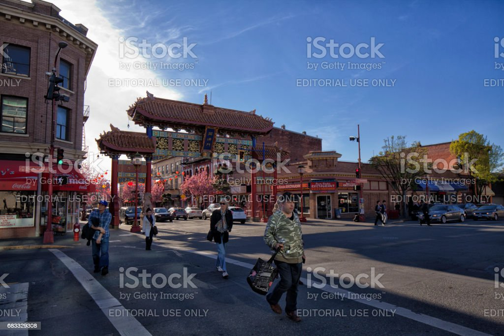 Intersection in front of Chinatown gate, Victoria, BC, Canada stock photo