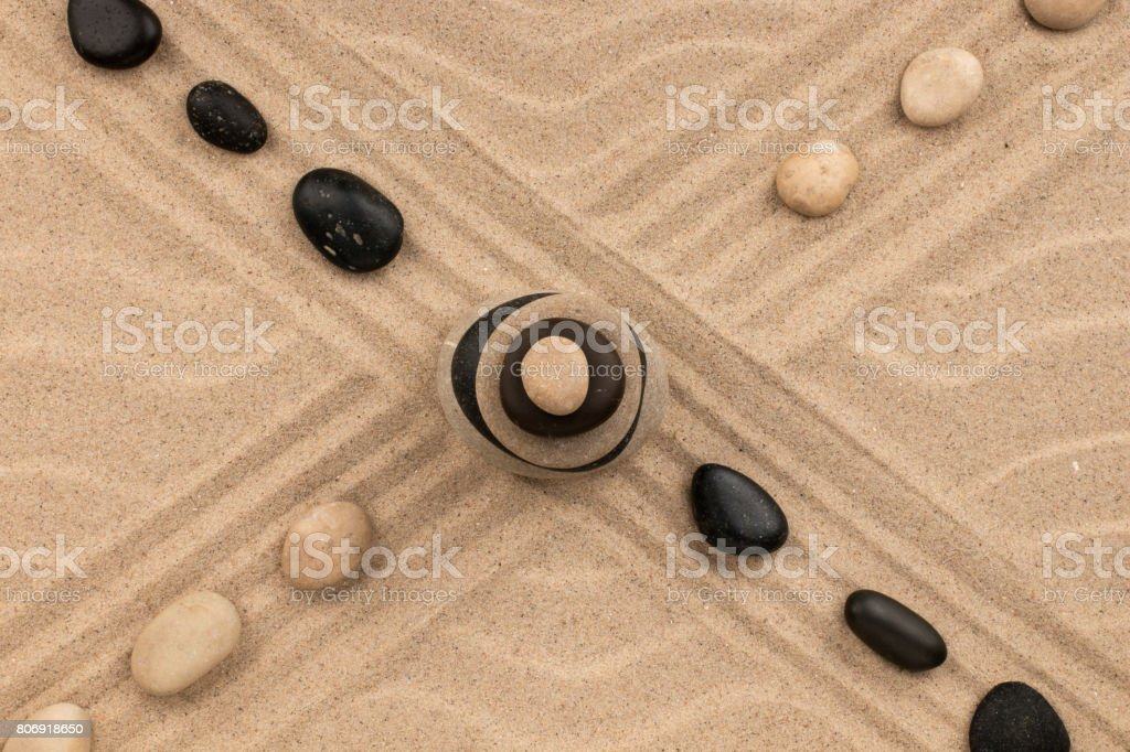Intersection of two lines consisting of stones and pyramid. stock photo