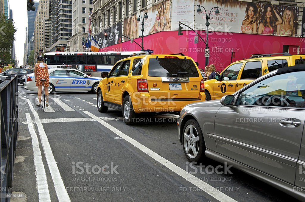 NYC Intersections, Bicyclist at 34th St & 6th Ave, Manhattan stock photo