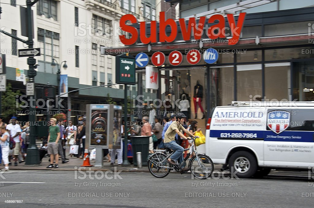 'NYC Intersections, Bicyclist at 34th St & 7th Ave, Manhattan' stock photo