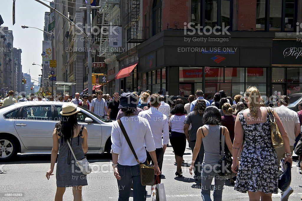NYC Intersections, pedestrians and auto, W.23rd St & 5th Ave royalty-free stock photo