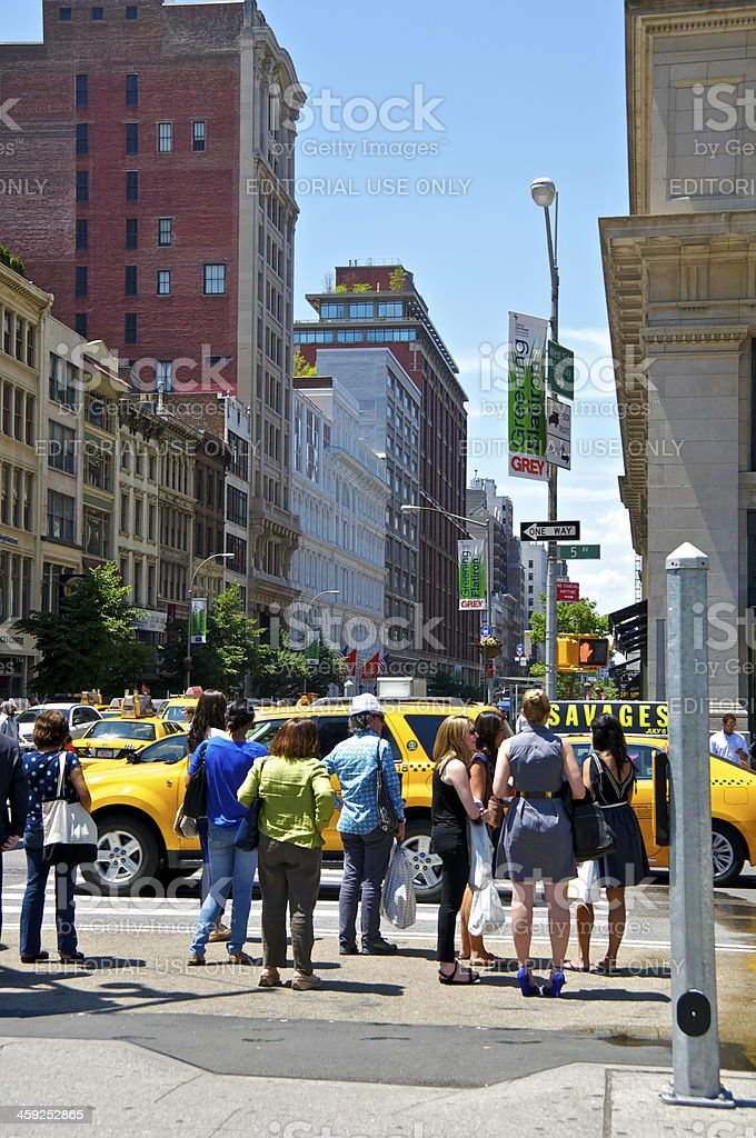 NYC Intersections, Pedestrians waiting to cross 5th Avenue, Manhattan royalty-free stock photo