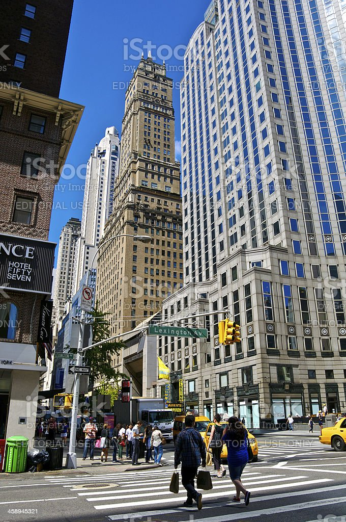 NYC Intersections, People at E.57th St & Lexington Avenue, Manhattan stock photo
