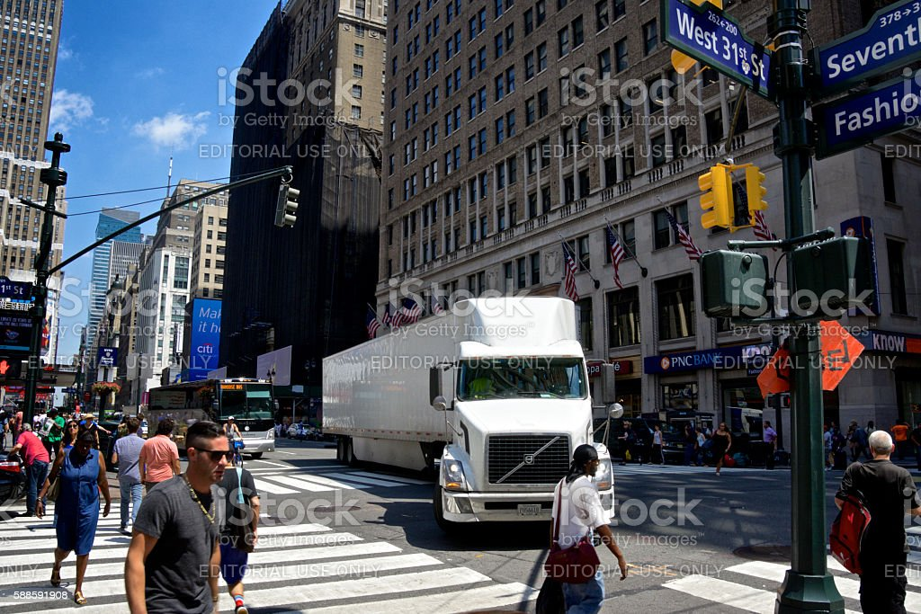 NYC Intersections, Tractor-Trailer and Pedestrians Crossing, 7th Avenue, Manhattan stock photo