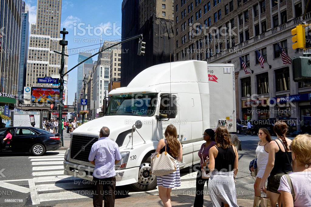 NYC Intersections, Tractor-Trailer turning, Pedestrians Waiting, 7th Avenue, Manhattan stock photo