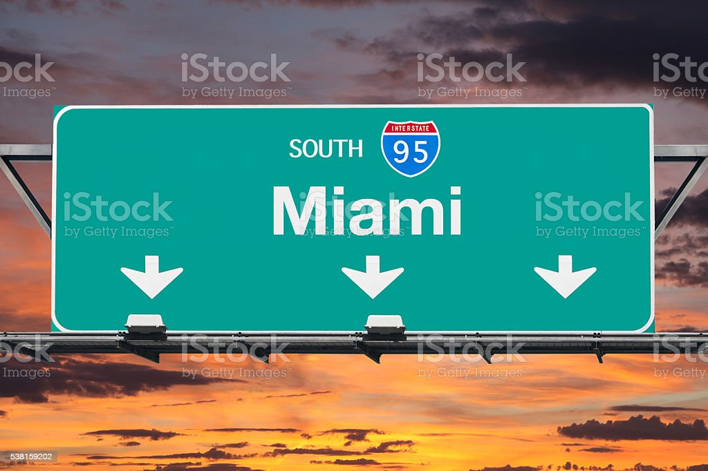 Interstate 95 South to Miami Highway Sign with Sunrise Sky stock photo