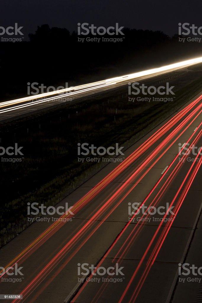 Interstate Highway at night stock photo
