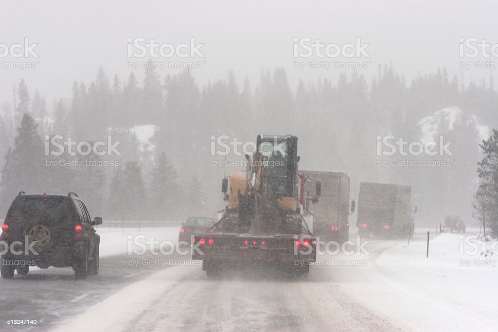 Interstate truck traffic winter blizzard Rocky Mountains Colorado snow stock photo