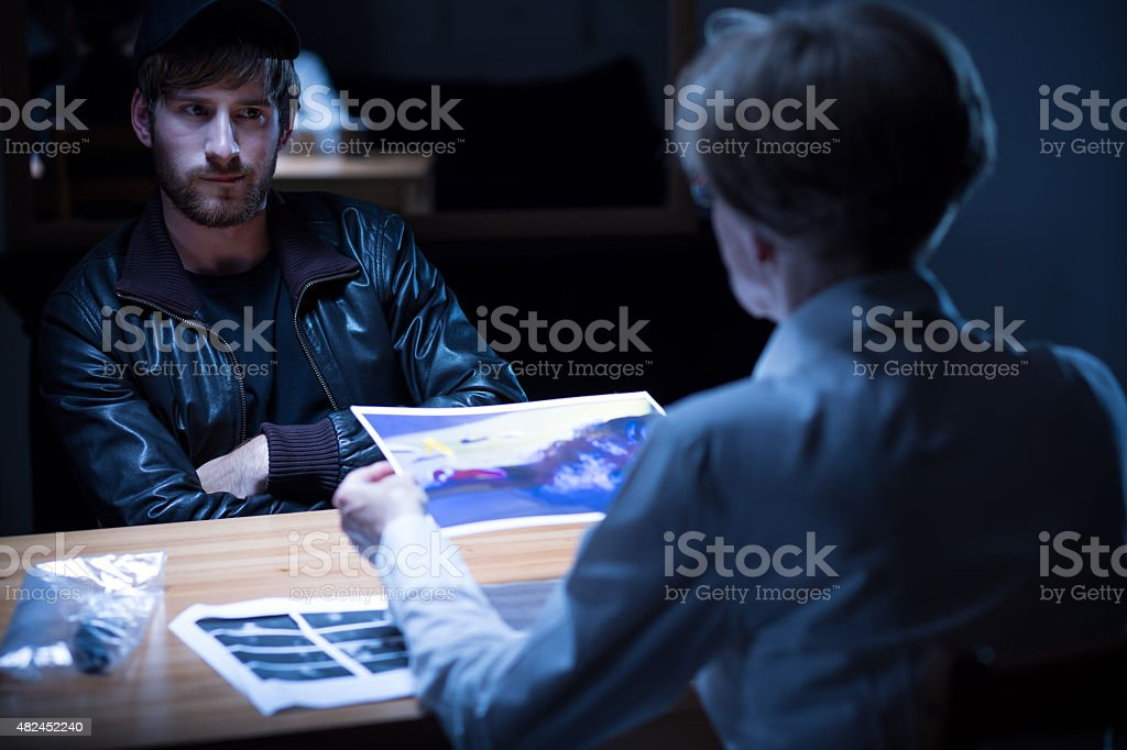 Interview in interrogation room stock photo