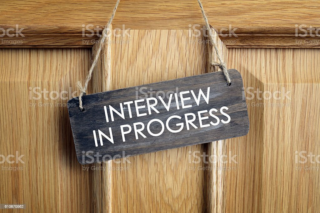 Interview in progress sign on office door stock photo