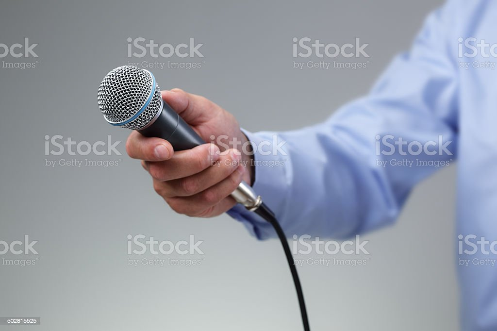 Interview with microphone stock photo