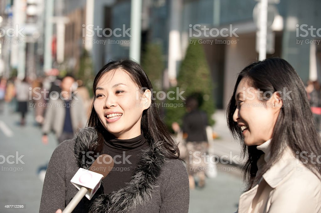Interview with two Beautiful Asian Woman stock photo