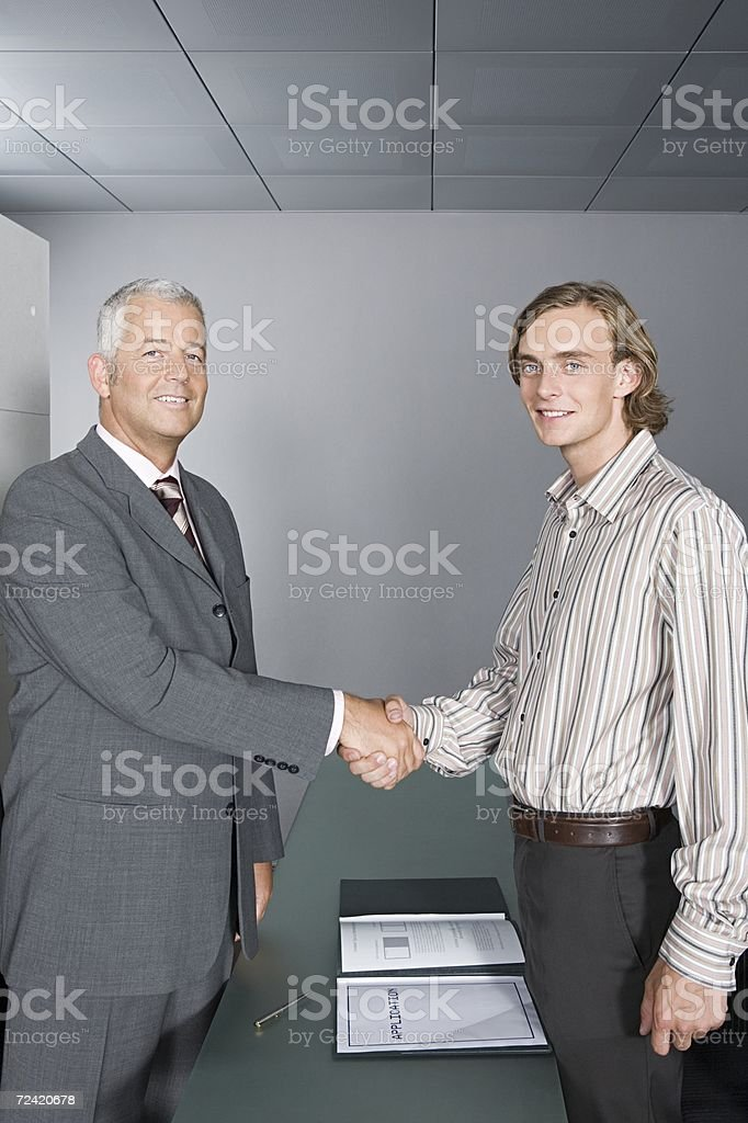 Interviewer shaking hands with interviewee royalty-free stock photo