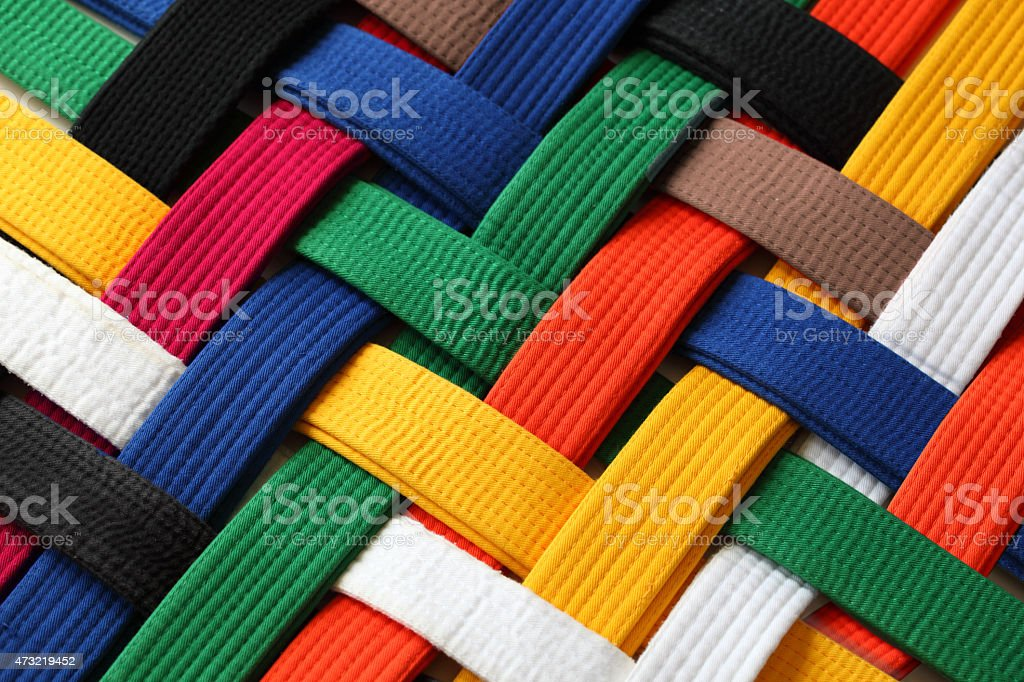 Interwoven colorful martial arts belts stock photo