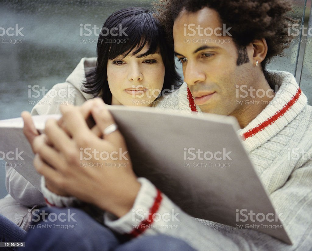 Intimate Couple Reading together royalty-free stock photo