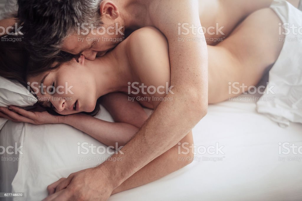 Intimate lovers making love in bed stock photo