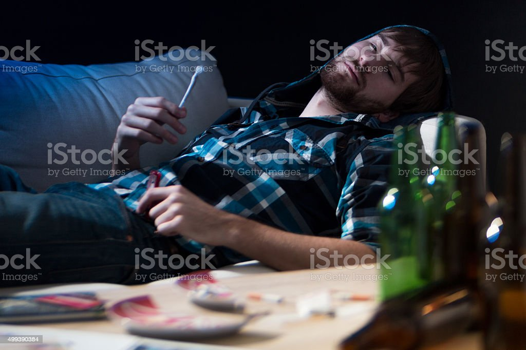 Intoxicated guy with a joint stock photo