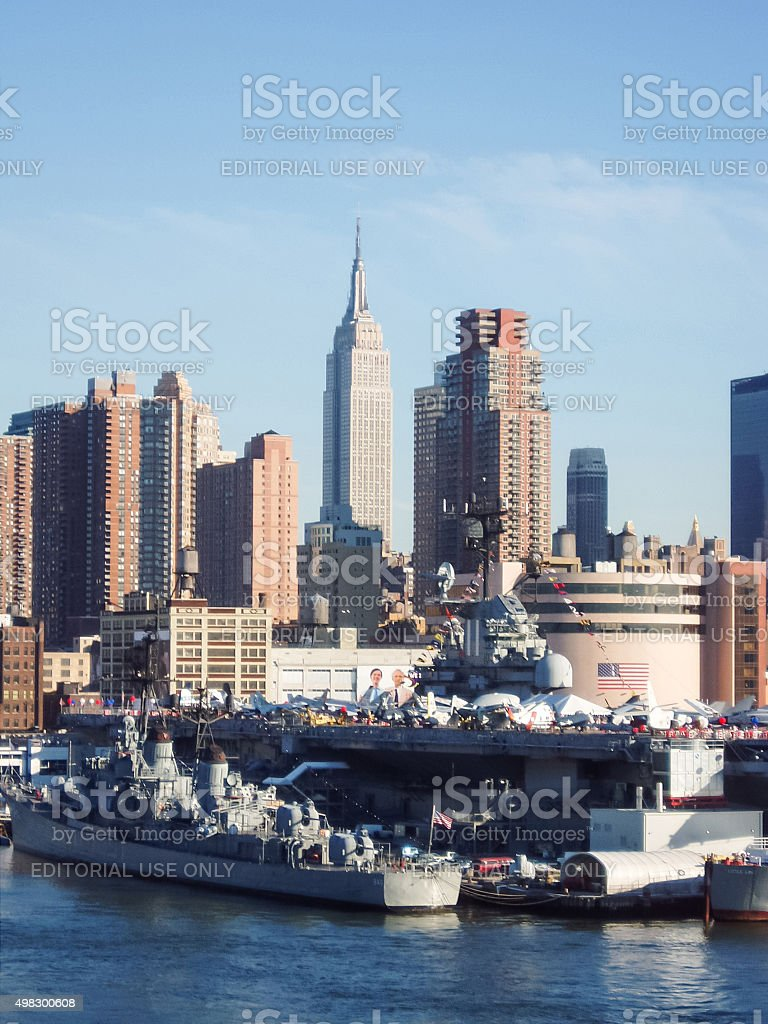 Intrepid museum and Empire State Building stock photo