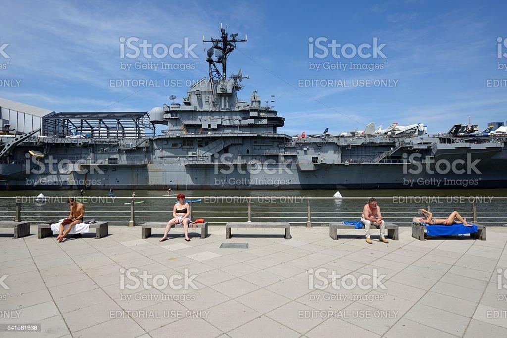 Intrepid Sea, Air & Space Museum with sunbathing people stock photo