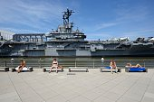 Intrepid Sea, Air & Space Museum with sunbathing people
