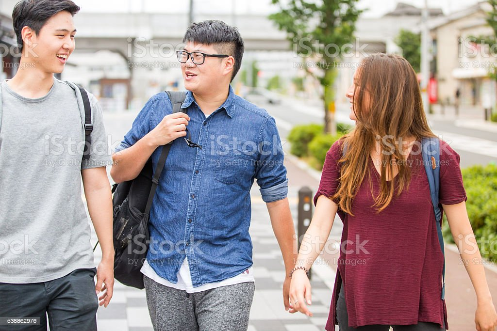 Intresting conversation between group of friends while headed for college. stock photo