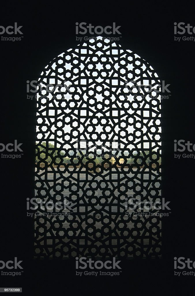Intricate design on a marble screen window over black stock photo