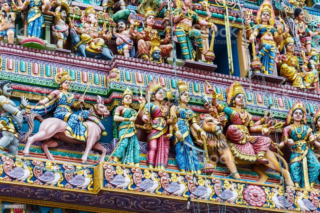 Intricate Hindu art and deity carvings on the facade of Sri Veeramakaliamman Temple in Little India, Singapore. stock photo