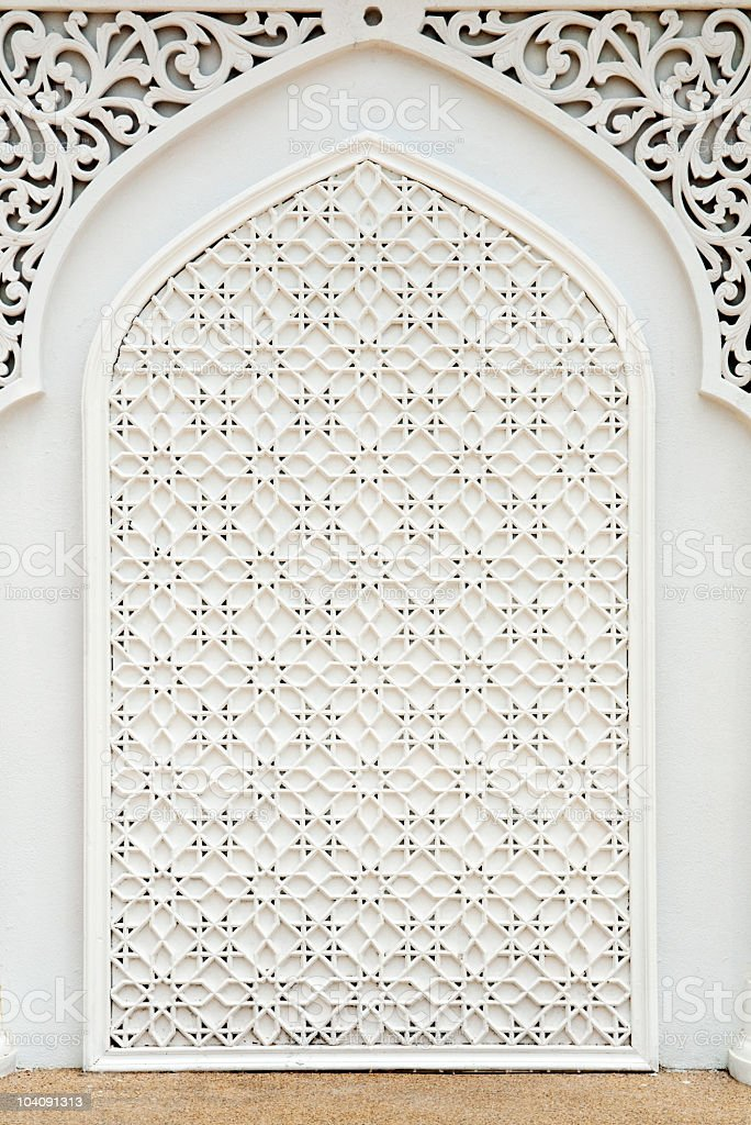 Intricate, white design on an Islamic mosque royalty-free stock photo