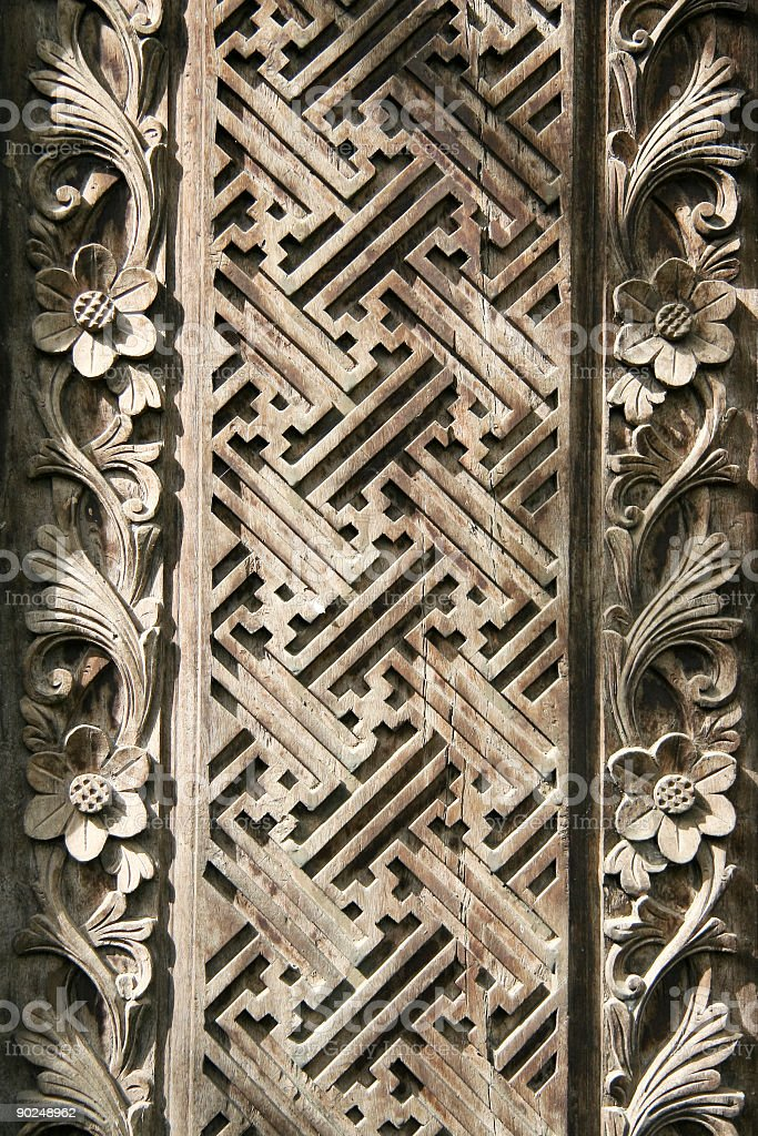 Intricate wood carving with flowers royalty-free stock photo