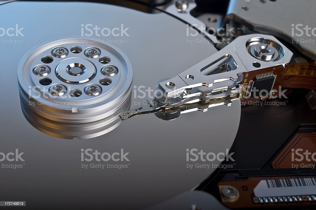 Intricate workings of a computer hard drive inside computer stock photo