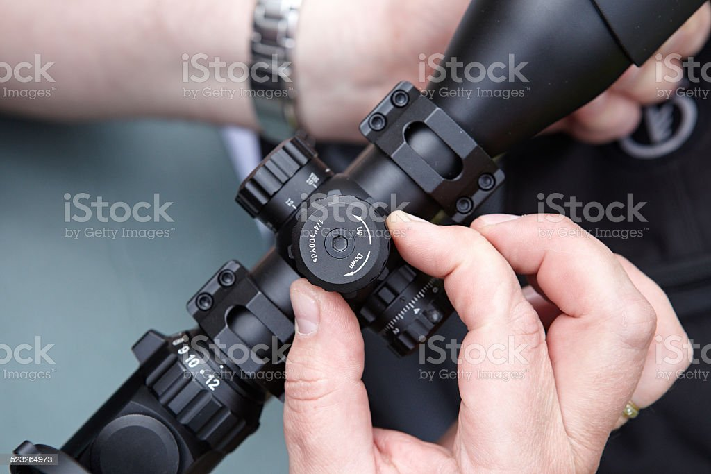 Introduction corrections in rifle shooting stock photo