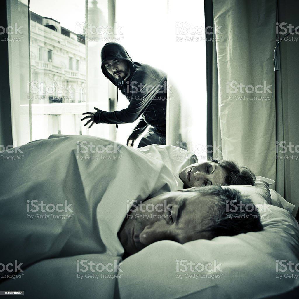 intruder breaking into an apartment royalty-free stock photo