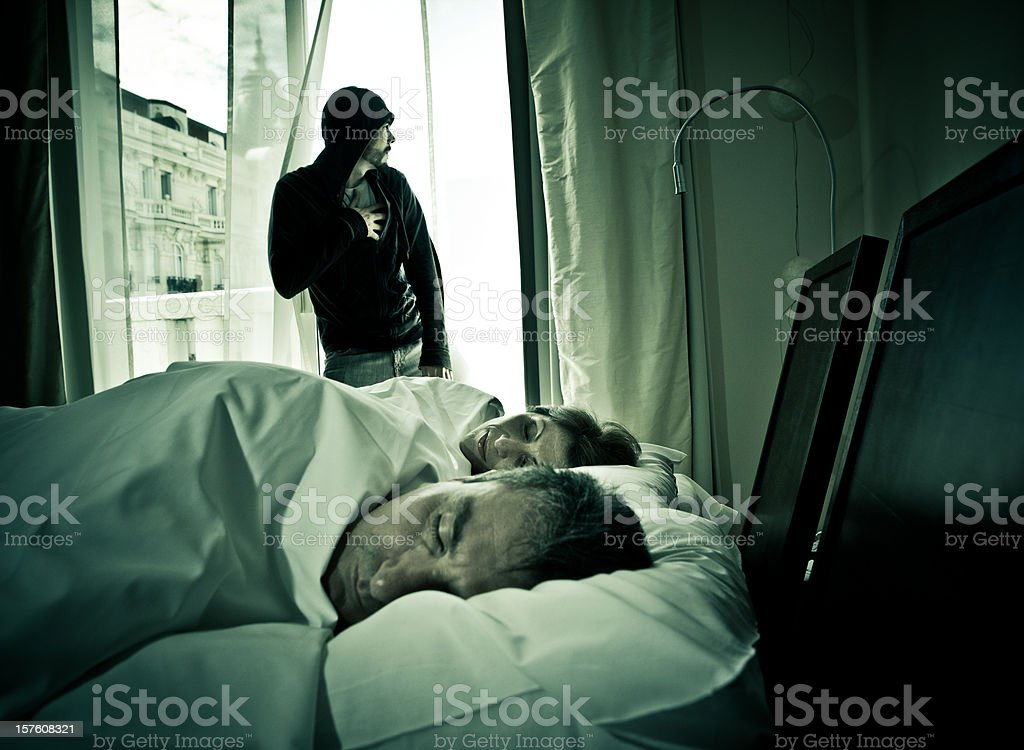 intruder breaking into an apartment stock photo