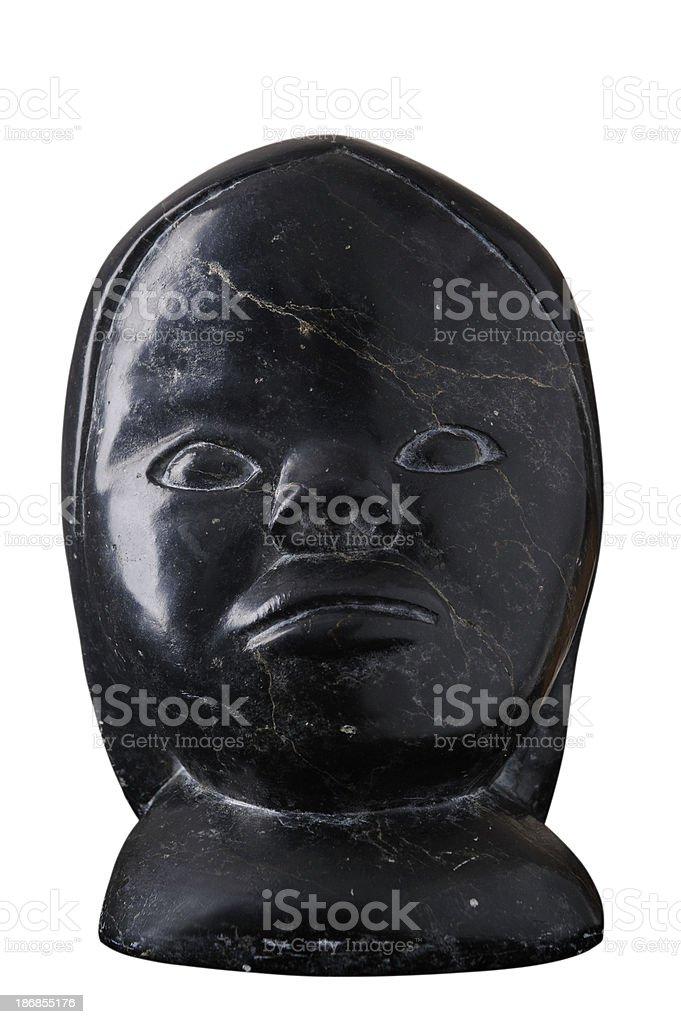 Inuit art carving, female head scupture stock photo