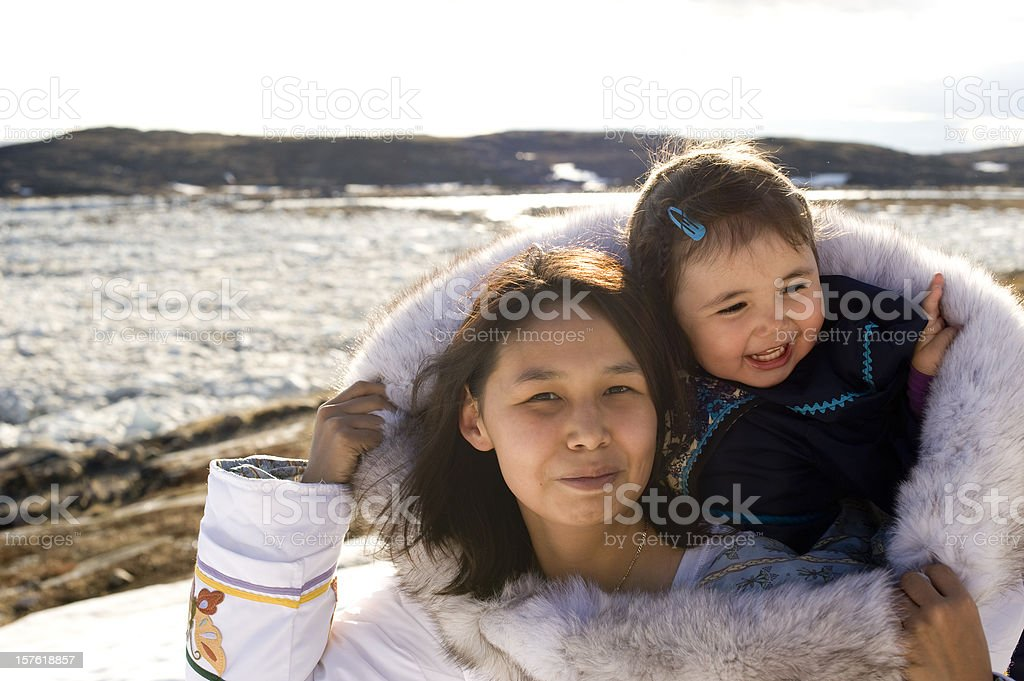 Inuit Mother and Daughter Traditional Dress Baffin Island Nunavut royalty-free stock photo